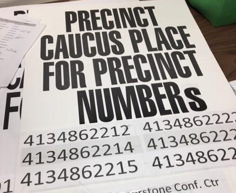 Caucus signs will be posted outside locations on Feb. 22. But with more and more candidates petitioning their way onto the ballot, is there still a need to caucus in Colorado?