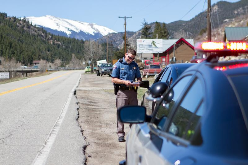 A Colorado State Patrol officer conducts a traffic stop.