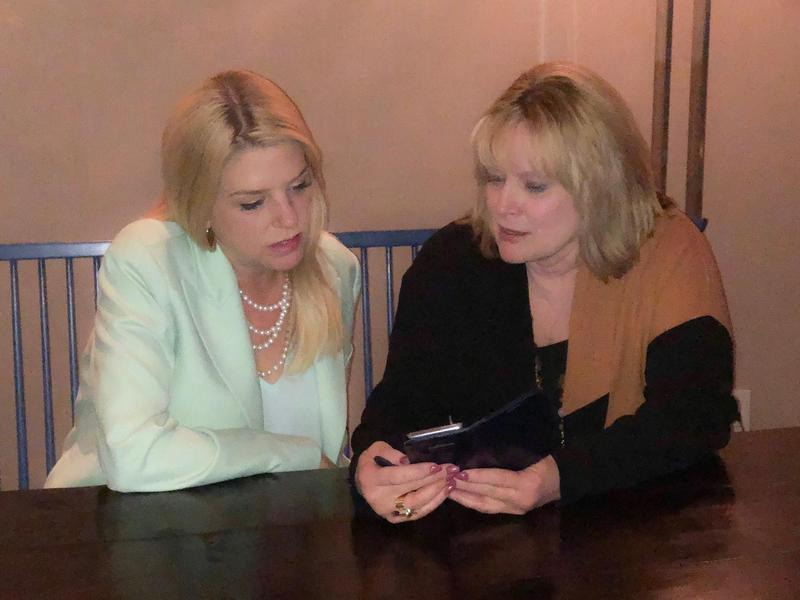 Colorado Attorney General Cynthia Coffman shows Florida Attorney General Pamela Bondi the Safe2Tell app during the National Association of Attorneys General meeting in Washington D.C. on Feb. 26, 2018.