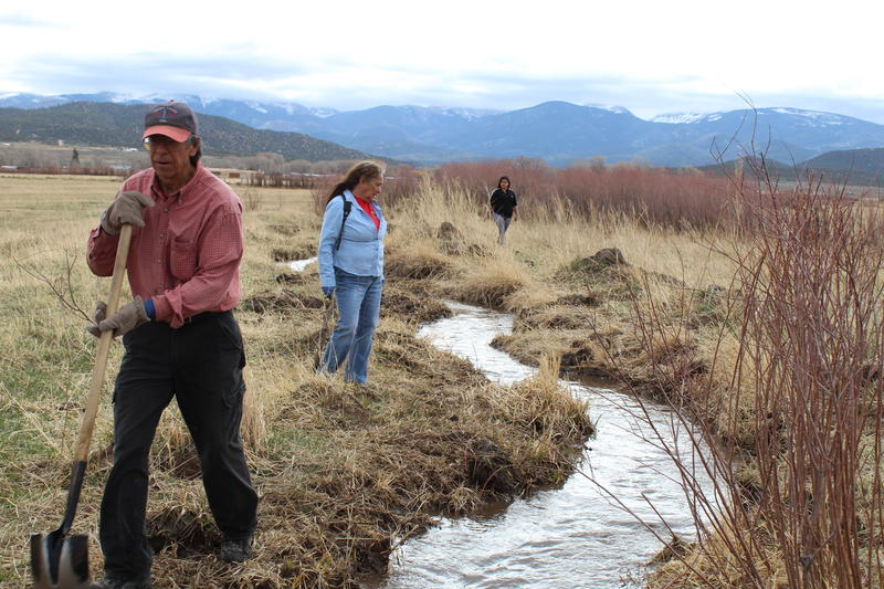 Dan Quintana (left) and Shirley Romero Otero (middle) participate in the spring limpieza, or ditch cleaning, along a ditch in rural Costilla County, Colorado.