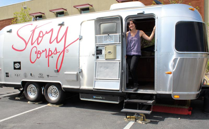 Jacqueline Van Meter stands in the doorway of the StoryCorps MobileBooth.