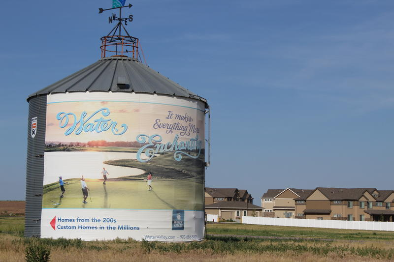 A grain silo serves as an advertisement for new homes in Windsor, Colorado, part of the expanding Water Valley development.