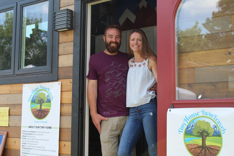 Ally Shea and Kevin Martin welcome visitors into their tiny home at the Colorado Tiny House Festival.