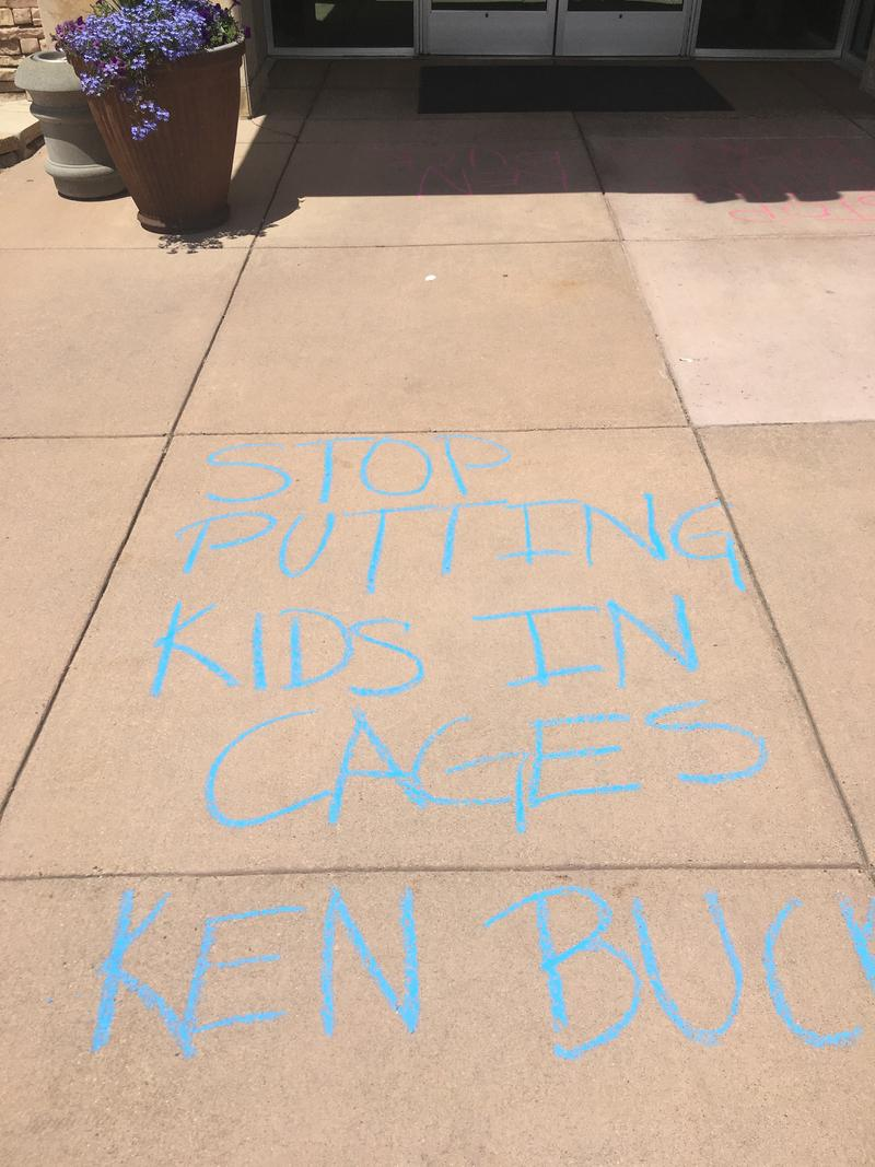 Colorado resident Shauna Johnson expressed her anger over migrant children being separated from their parents in a chalk message to Rep. Ken Buck. She was later charged with criminal tampering, but that charge has now been dropped.