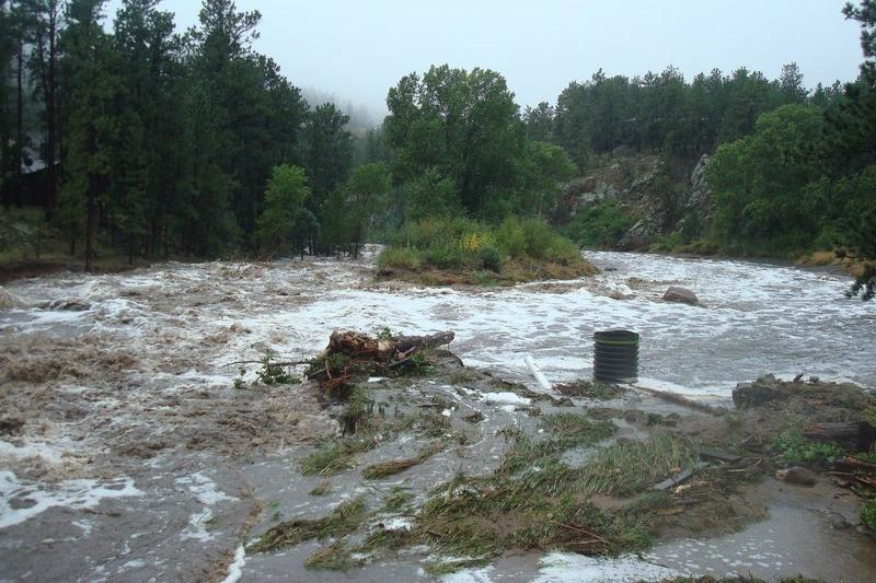 In this photo taken Sept. 12, 2013, the Little Thompson River overflowed its banks to join with a nearby lake.