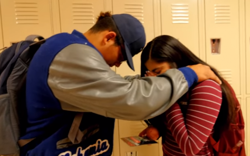 A screenshot from the new video shows a classmate comforting a girl dealing with thoughts of suicide.