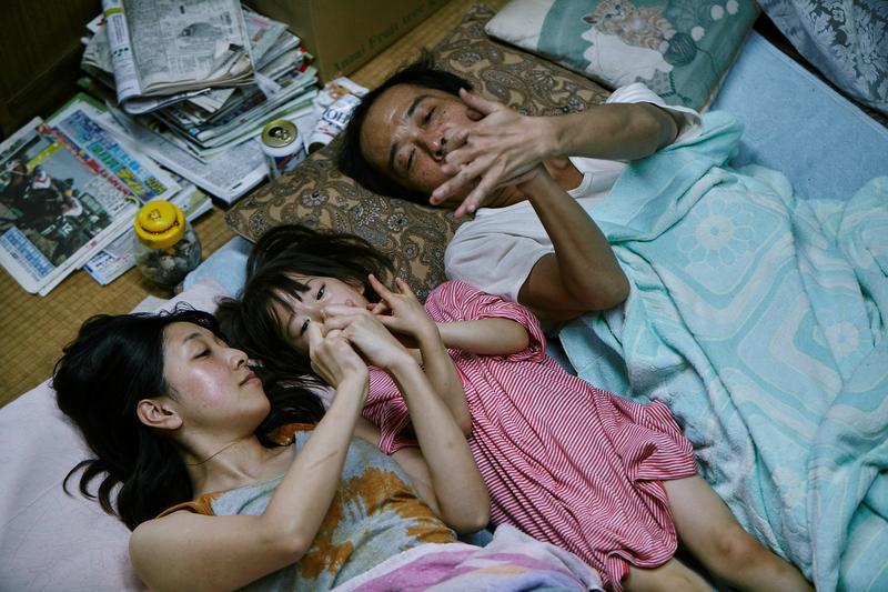 Ando Sakura, Sasaki Miyu, and Lily Franky in a scene from Shoplifters, directed by Hirokazu Kore-eda.