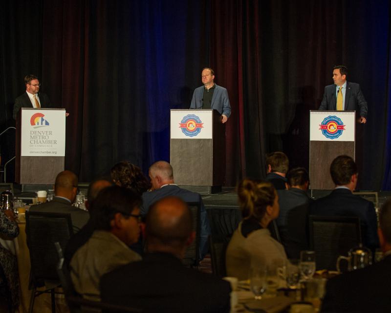 Ed Sealover (left), Denver Business Journal reporter, moderates the debate between Democrat Jared Polis (center) and Republican Walker Stapleton (right) on Oct. 5 at the Hyatt Regency in Denver.