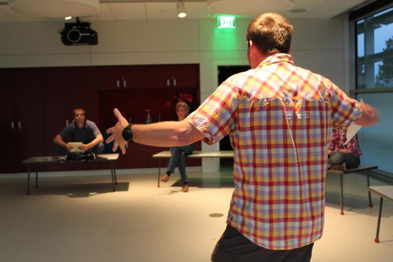 Science Riot student Brandon Dugan, who teaches geophysics at the Colorado School of Mines, emphasizes a point during his comedy set on how squeezing mud helps him learn more about underwater landslides.
