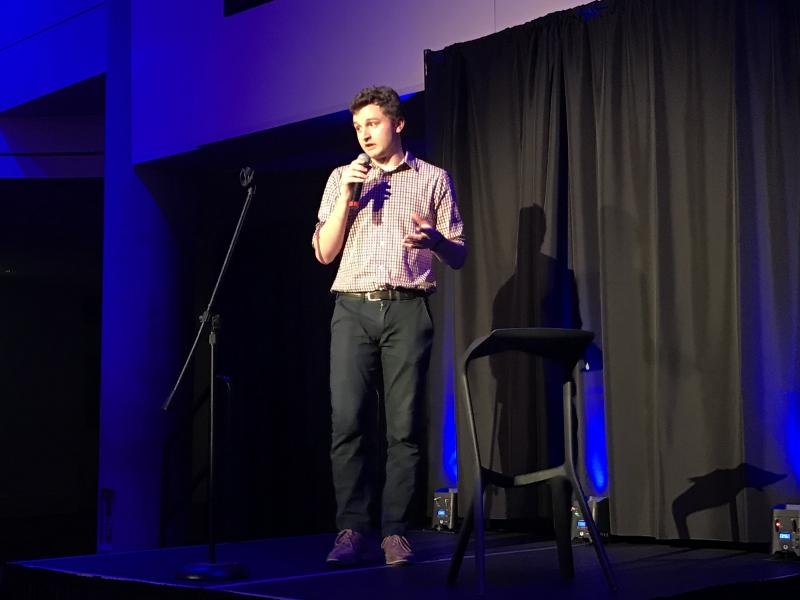 """Science Riot student Cam Harvey performs a set on """"geodesy,"""" or the study of the Earth's shape, orientation in space and gravitational field."""
