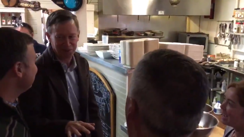 Gov. John Hickenlooper at a coffee shop in New Hampshire, where he told an employee he was running for president before immediately walking it back.