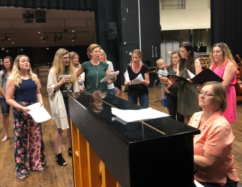Over 50 Rocky Mountain High School graduates gathered to perform a tribute video to their choir teacher Barbara Lueck, who is being treated for cancer.