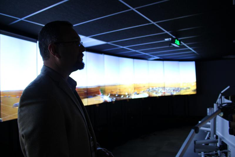 Jason Licon, director of the Northern Colorado Regional Airport, stands in front of a live feed of the tarmac. From his view in the airport's new remote tower, he can see every movement in and out of the facility.