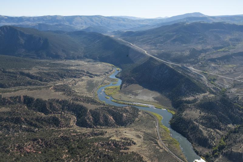 The Colorado River flows near Kremmling, Colorado. The 1,450 mile stream supplies water to roughly 40 million people in seven U.S. states and Mexico.