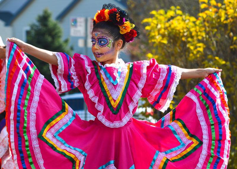 A dancer performs at the Longmont Museum's Dia de los Muertos celebration.