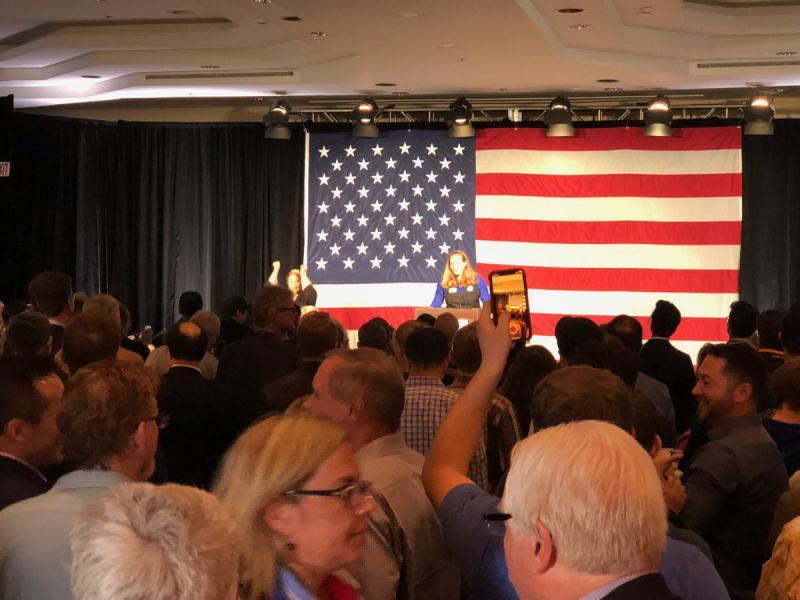Democrat Party Chair Morgan Carroll speaks at the Democrat watch party in Denver.