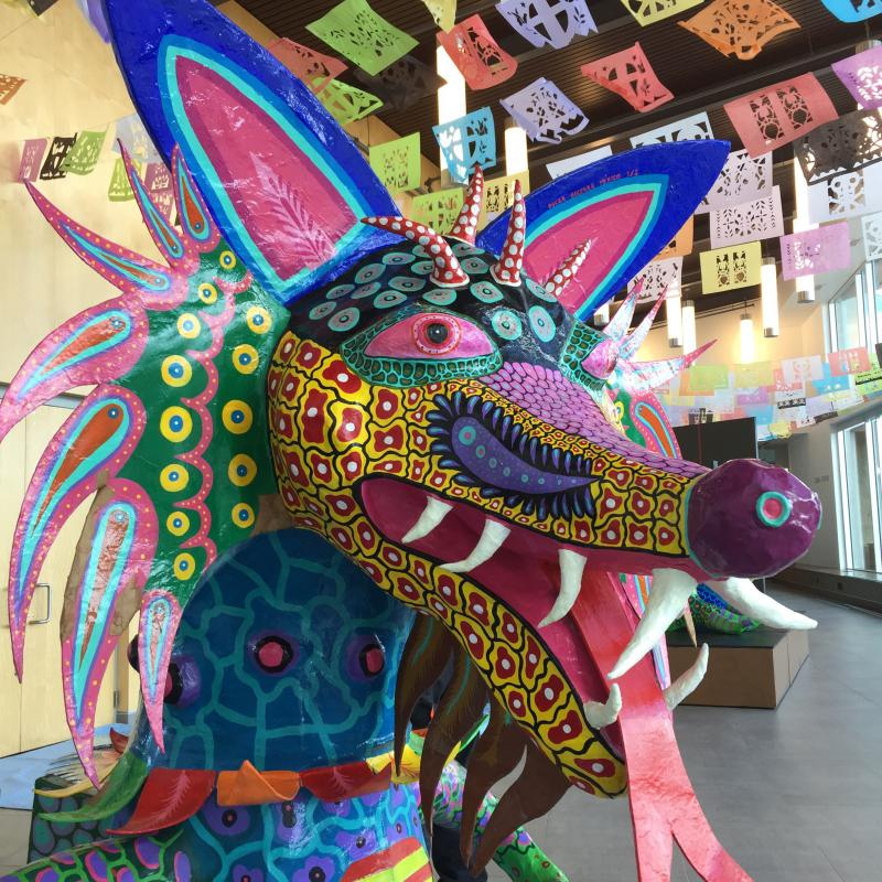 'Xólotl: Dios Perro' is a monumental alebrije sculpture by international artist Oscar Becerra and a featured part of this year's exhibit. Alebrije are brightly colored Mexican folk art sculptures of fantastical creatures.