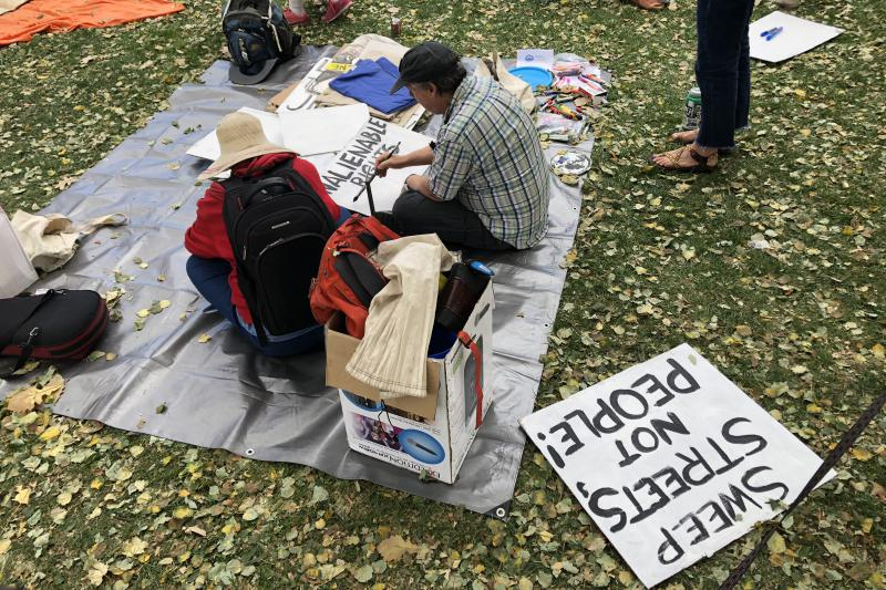 Supporters of the Right to Survive initiative make signs at Civic Center Park in October. Denver voters will be asked in May whether the urban camping ban should be repealed.
