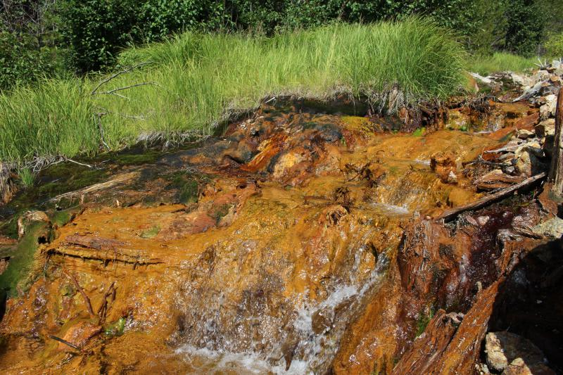 Drainage from an abandoned mine in Clear Creek County, Colo. stains a creek bed a sickly shade of orange.