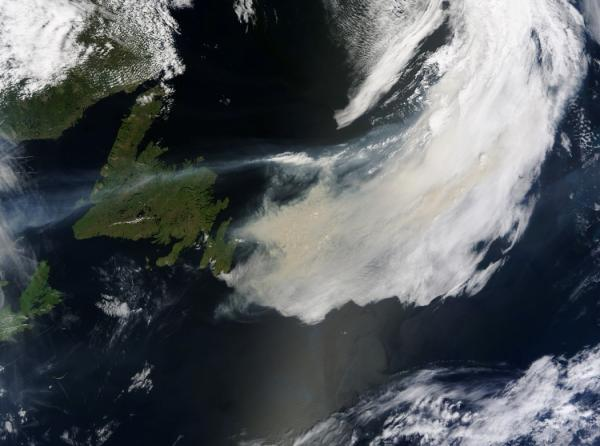 Wildfire smoke over the North Atlantic Ocean, the smoke is light brown versus the white clouds, taken June 23