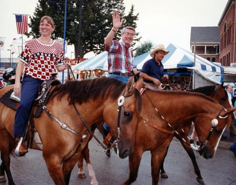 As state secretary of agriculture, Beck Doyle and Gov. Jim Edgar, center, ride through the 1991 Illinois State Fair.