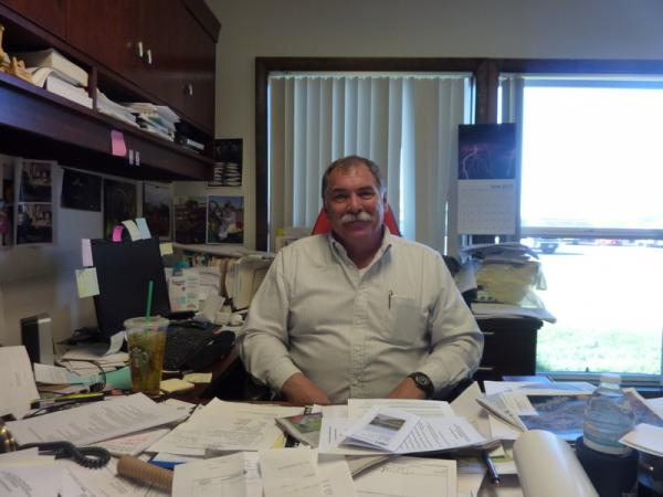 Steve Vandiver, General Manager of the Rio Grande Water Conservation District in his office in Alamosa. He is charged with stopping the depletion of the aquifer in San Luis Valley. He is working to create sub districts.