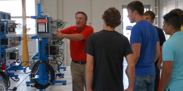 Program director Bruce Beardsley demonstrates equipment in the new oil & gas lab to new students.