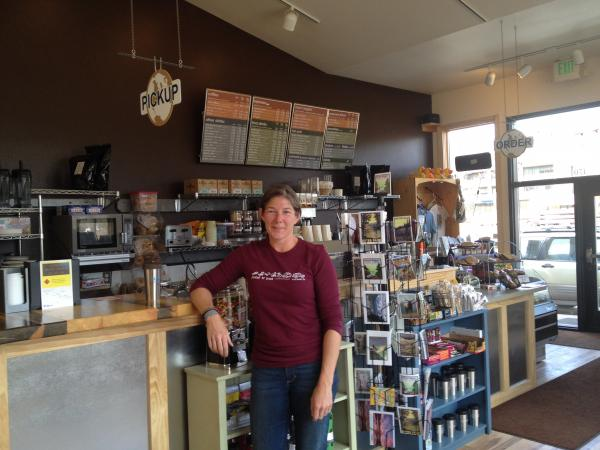 Amy Hamrick, owner of Kind Coffee, stands in her newly rebuilt store after it was flooded in September 2013.