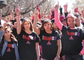People at the 2013 One Billing Rising event in Santa Fe, NM, raise their hands when asked if anyone in their family has been abused or if they want to make sure they don't get abused.
