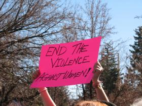 End Violence Against Women Sign during One Billion Rising event at the state capitol on Valentine's Day, 2013.