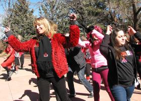 Carrie McCarthy, a V-Day and One Billion Rising volunteer, dances with others in a flash mob dance.