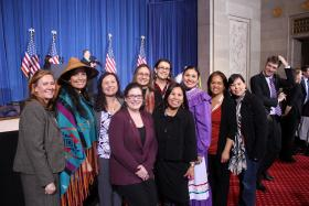 Members of the National Congress of American Indians attended the signing ceremony for the Violence Against Women Act.