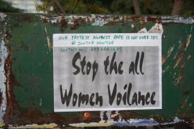 Protest sign in New Delhi