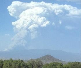 The Jaroso Fire sent a huge cloud of smoke into the air Tuesday as it burnt through areas of dead and downed trees.