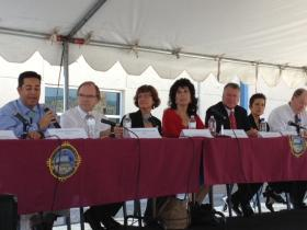 (L-R) US Rep. Ben Lujan, NM AG Gary King, HSD's Julie Weinberg, St. Sen. Linda Lopez, Health Exchange IT Bob Meyer, HSD's Diana McWilliams, Primary Care Assoc.'s David Roddy