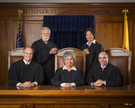 bottom: Justice Richard C. Bosson, Chief Justice Petra Jimenez Maes, Justice Edward L. Chavez, top: Justice Charles W. Daniels, Justice Barbara J. Vigil
