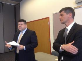 Luis Salcedo (left) with the Civil Rights Division of the Department of Justice and Damon Martinez, U.S. attorney for New Mexico on Monday, April 28, 2014, at the Alamosa Community Center.