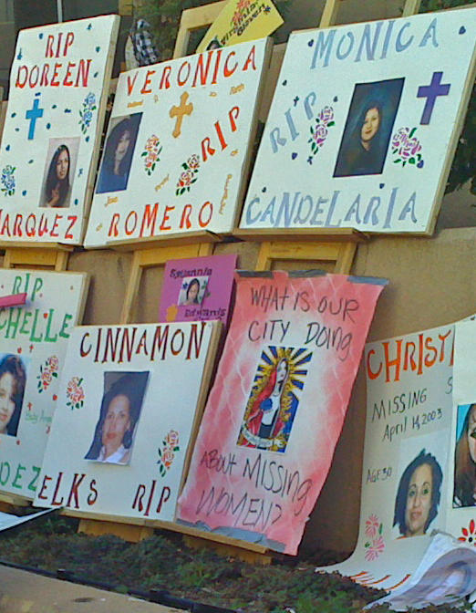 Memorials to the women found buried on the the West Mesa at a demonstration in front of police headquarters in Albuquerque.