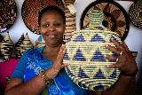 Janet Nkubana of the Gahaya Links Cooperatives, Rwanda, at the Santa Fe International Folk Art Market.