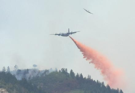 A MAFFS C-130 drops its payload over the Waldo Canyon Fire in Colorado.