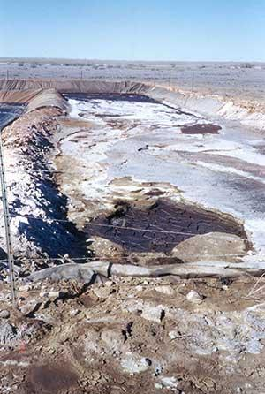 Salt build-up and torn liner on pit in New Mexico