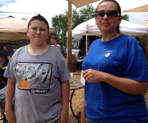 Zachary Lewis and his mom Laurie Baldonado take a break at the Espaõla Farmers Market