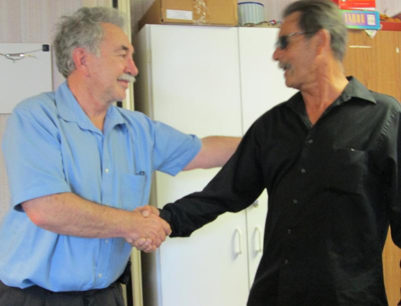 Client David Ruiz (R) thanks CEO Sam Vigil for providing services at Valencia Counseling Service
