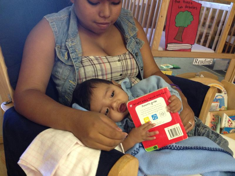Karla reads to Harley at Santa Fe High's daycare center