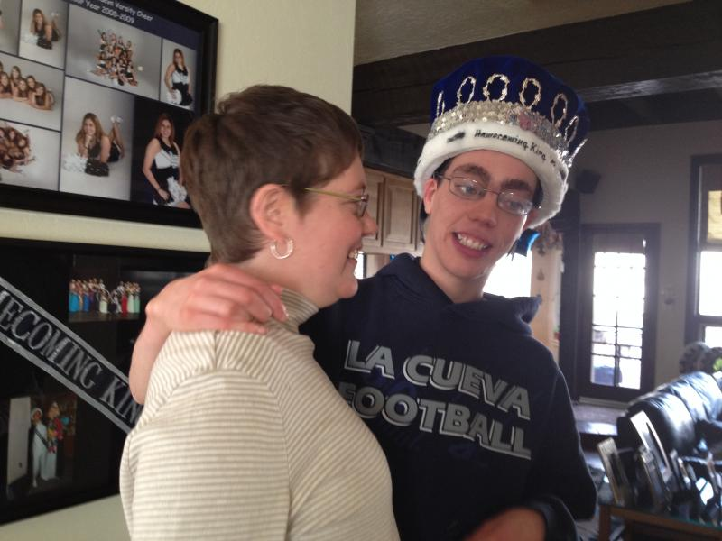 Lesly admires brother Noah's Homecoming King Crown