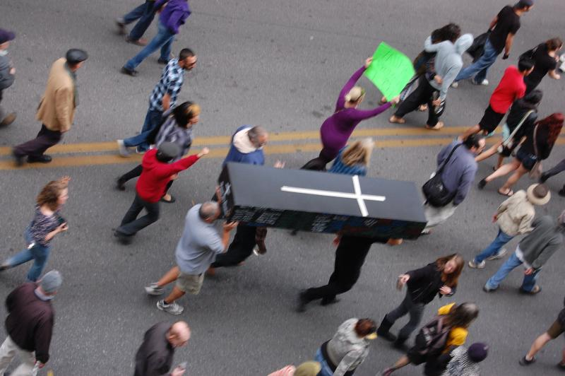 A mock coffin, with the names of all the victims that have been fatally shot by Albuquerque Police since 2010, was paraded through the streets.