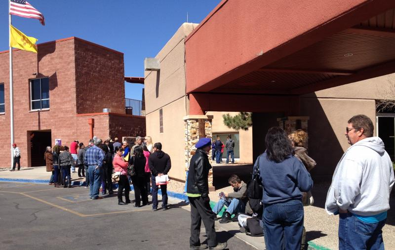 Young Invincibles and older adults and families wait to sign up for healthcare in Santa Fe