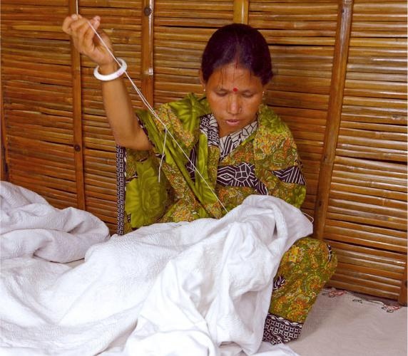 Sona Rani Roy of Bangladesh with a white-on-white quilt.