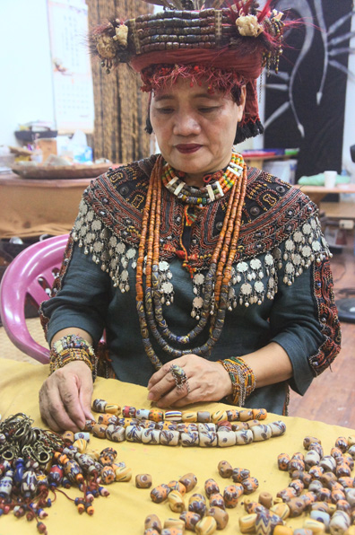 Ya-Lei Chang, Taiwan, shows her glass beads.