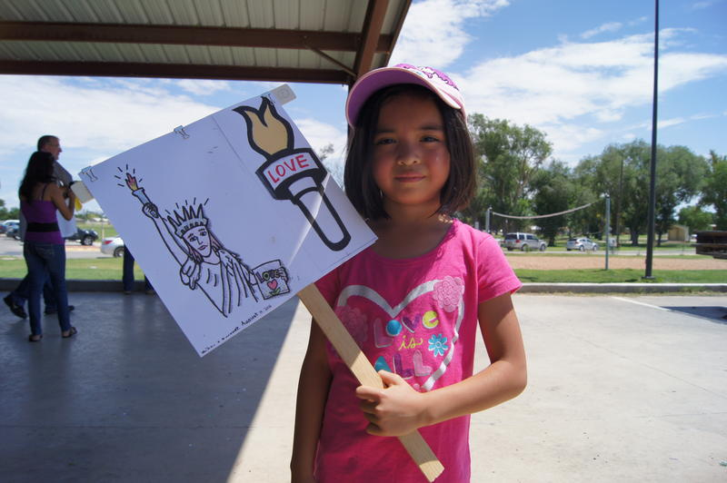"Seven year-old Artesia resident Paikea Marquez is the daughter of march organizer Noel Marquez. She said she came to support the detainees. ""We should let them out, because they're getting killed"" in Central America, she said."